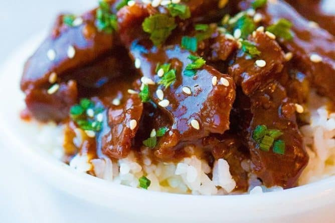 Instant Pot Mongolian Beef in a bowl over rice