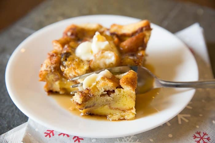 Serving of Cinnamon Rolls French Toast Casserole in White Plate