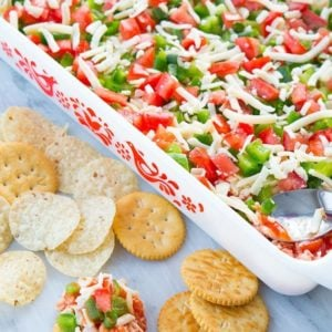 Shrimp Dip in white Pyrex baking pan and in chips and crackers