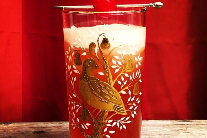 Singapore Sling in a vintage partridge in a pear tree glasses garnish with cherry on pick