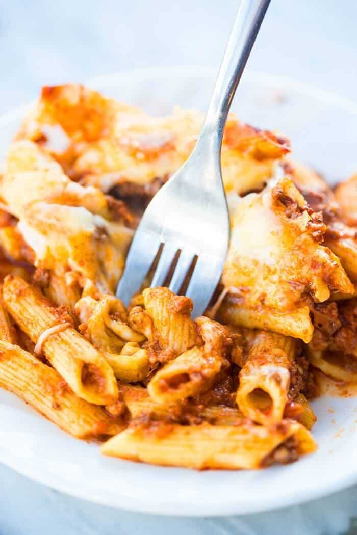 close up of Slow Cooker Baked Ziti in serving plate with fork