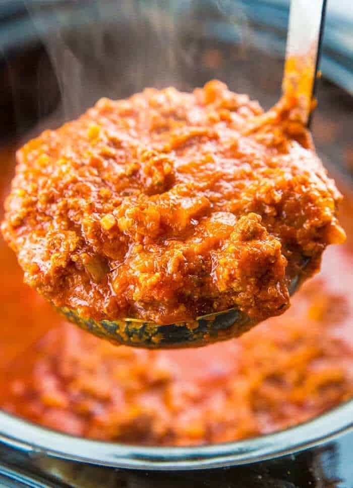 a scoop of Bolognese Sauce from slow cooker