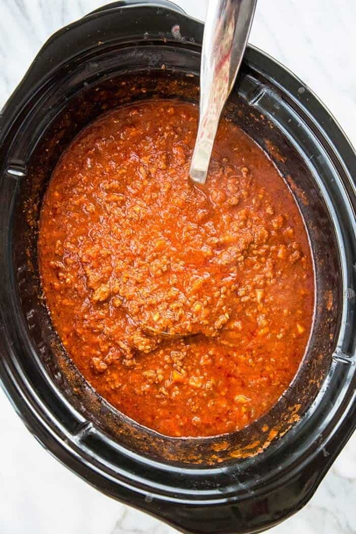 Stirring the Bolognese Sauce in slow cooker