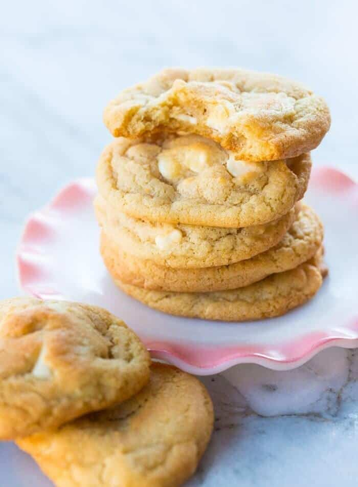 stack of smaller sizes Chocolate Chip Macadamia Nut Cookies in a white plate