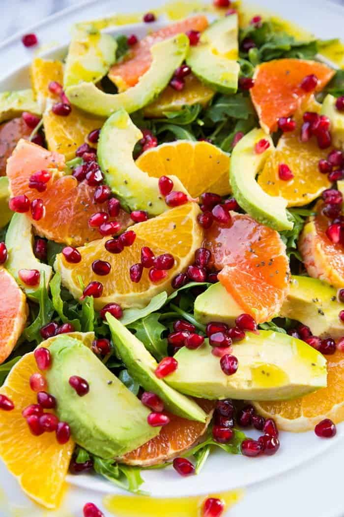 close up Winter Citrus Avocado Salad - citrus, avocado, pomegranate and arugula