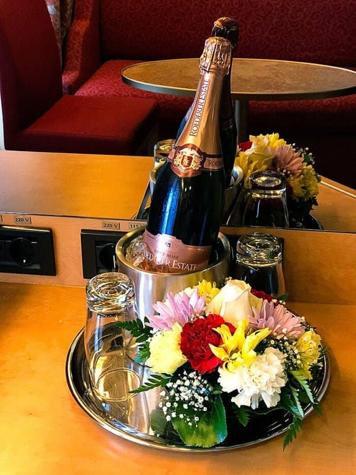 flowers and two bottles of champagne