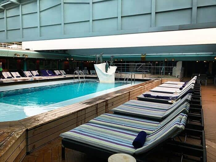the pool area with the retractable roof
