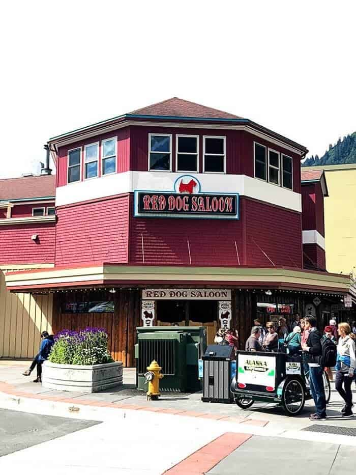 Red Dog Saloon - red colored building with logo of dog