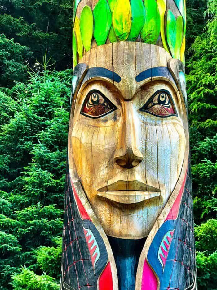 large totem poles in the woods inside Sitka National Park