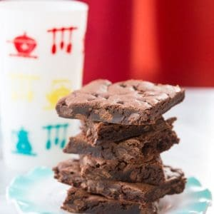 stack of Cake Mix Cookie bars in a blue plate on red background