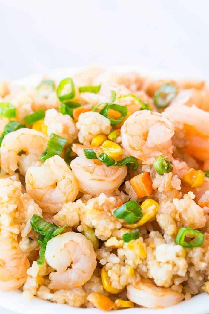 close up of Shrimp Fried Rice topped with chopped green onions