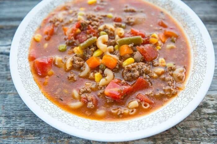 Hamburger Soup With Elbow Macaroni and Vegetables in a Soup Bowl on Wood Background