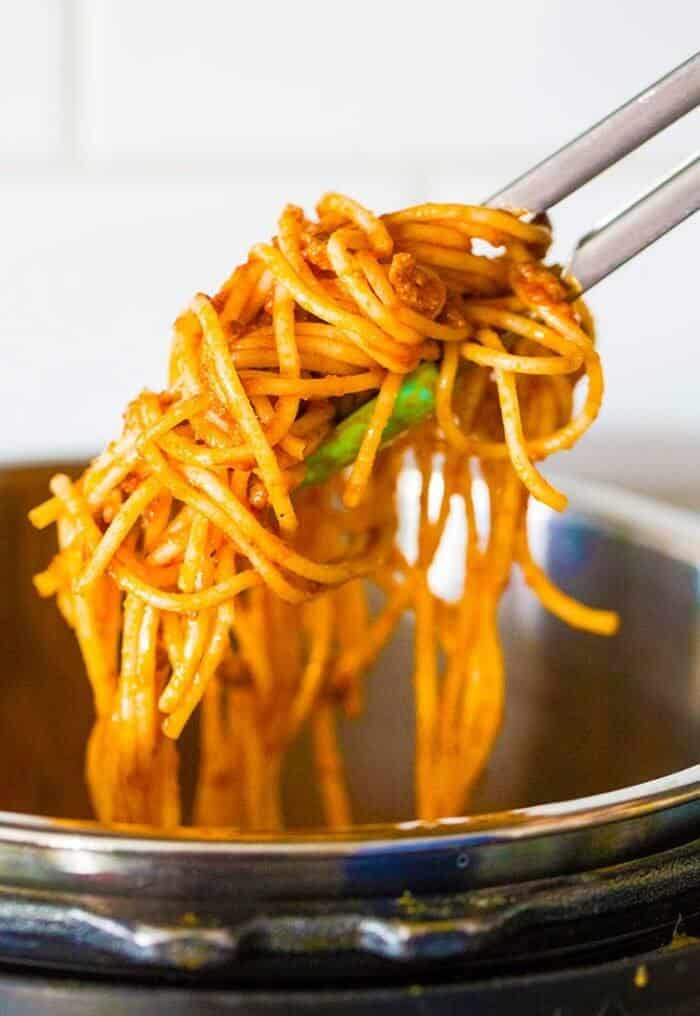 getting some instant pot spaghetti using kitchen tongs