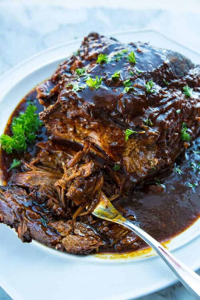 using a fork to get some Slow Cooker Brisket with root beer and BBQ sauce