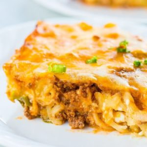 Slice of Sour Cream Ground Beef Noodle Casserole in a White Plate