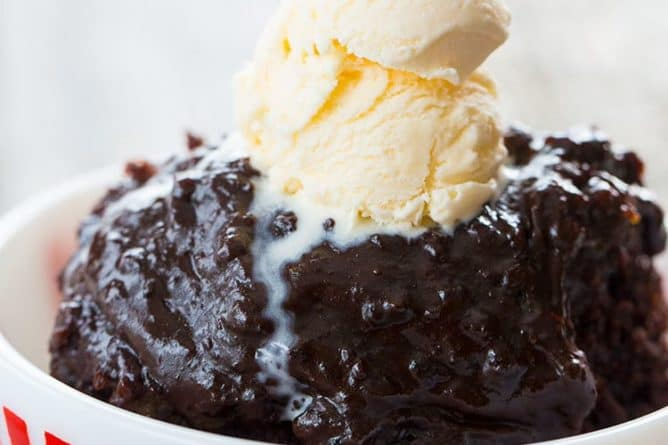 Close up of Chocolate Slow Cooker Lava Cake in a Bowl Topped with vanilla ice cream