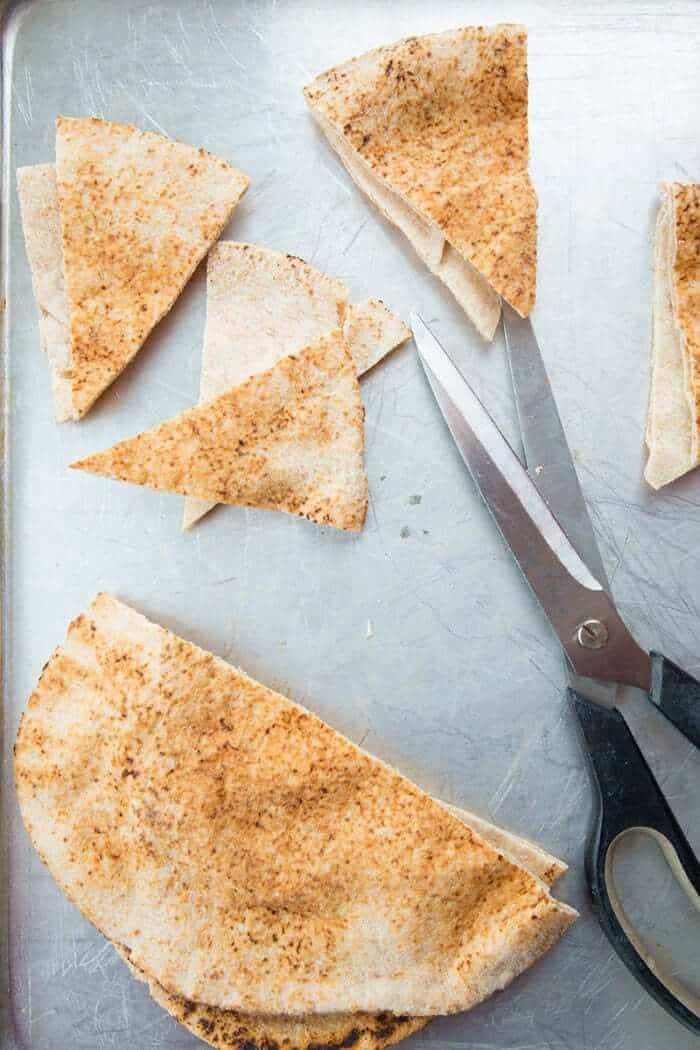 Homemade Pita Chips Being Cut With Scissors