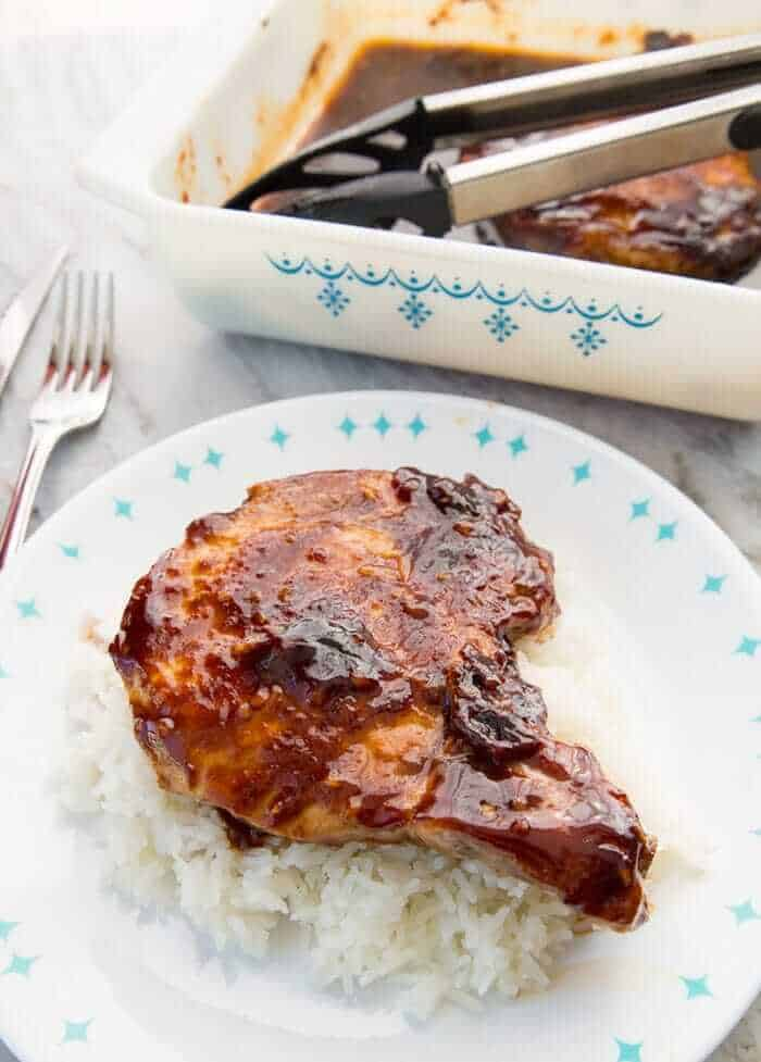 Saucy Brown Sugar Baked Pork Chops with Pyrex Snowflake Garland pan in the background