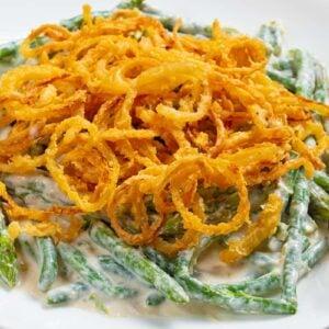 close up Asparagus Green Bean Casserole in a white plate