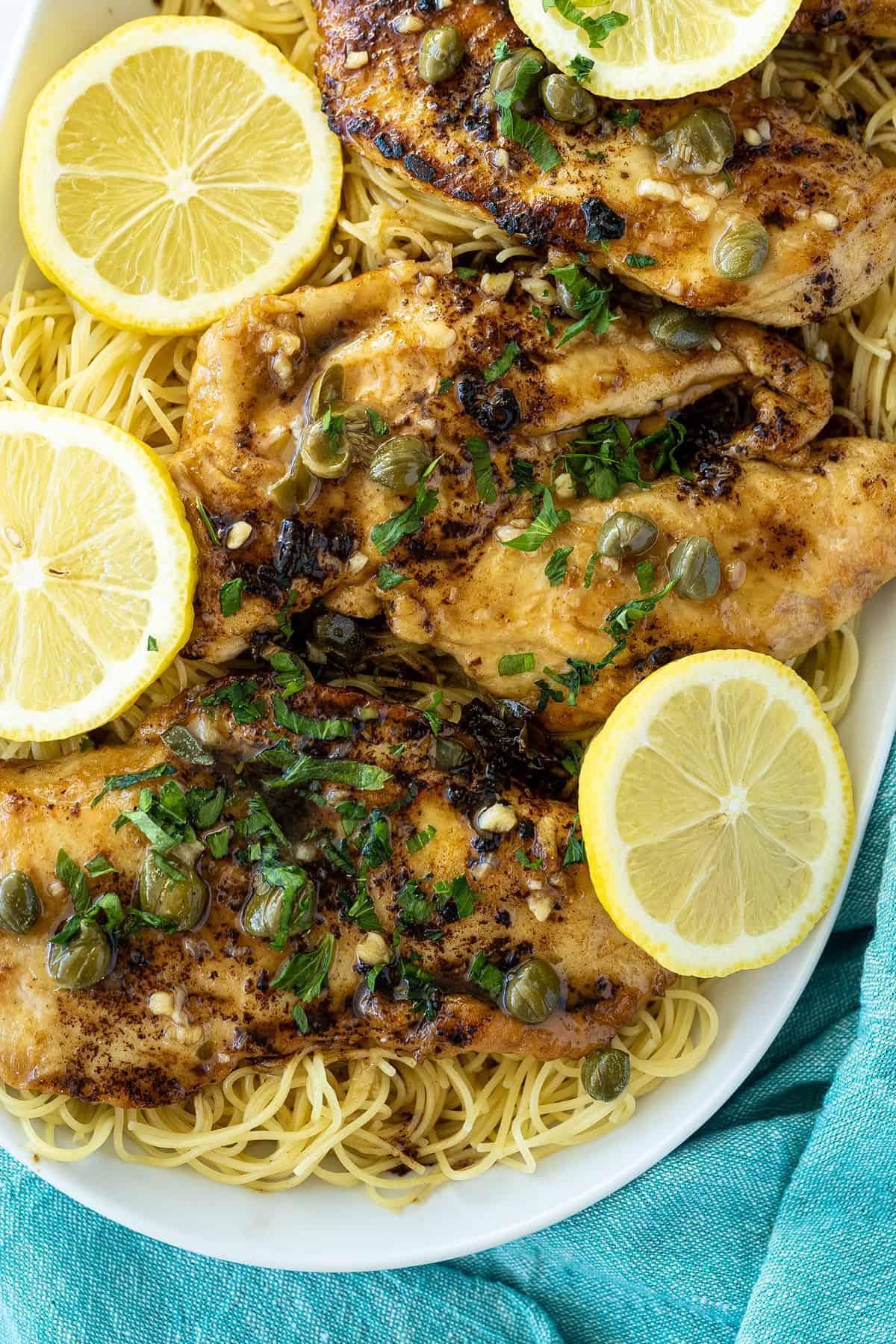 chicken piccata on a white platter