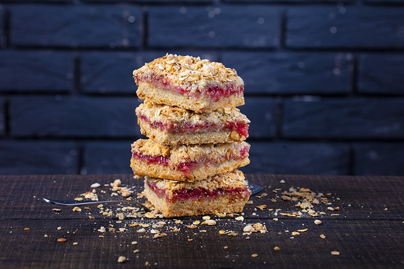 stack of soft and chewy cranberry oatmeal bar cookies