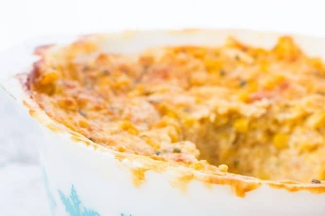 Scalloped Corn Casserole in a Pyrex Turquoise Snowflake Casserole dish