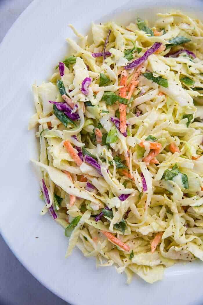 Close up of classic homemade coleslaw on a white plate