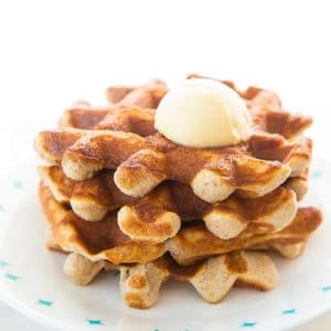 Close up of Keto waffles on a white Corelle plate and butter on top