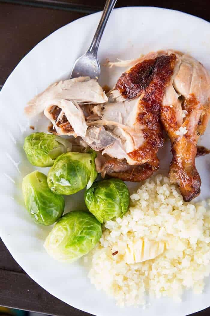 Carved up rotisserie chicken with Brussels sprouts & riced cauliflower
