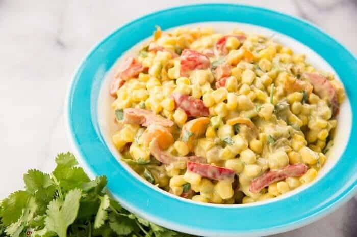 A plate with Creamy Corn Salad with Green Chile Dressing