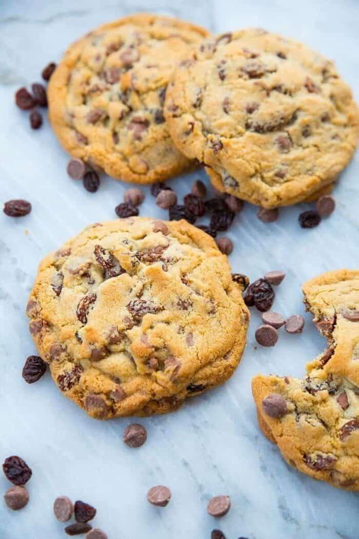 Milk Chocolate Chip Cookies with Raisins on white marble slab