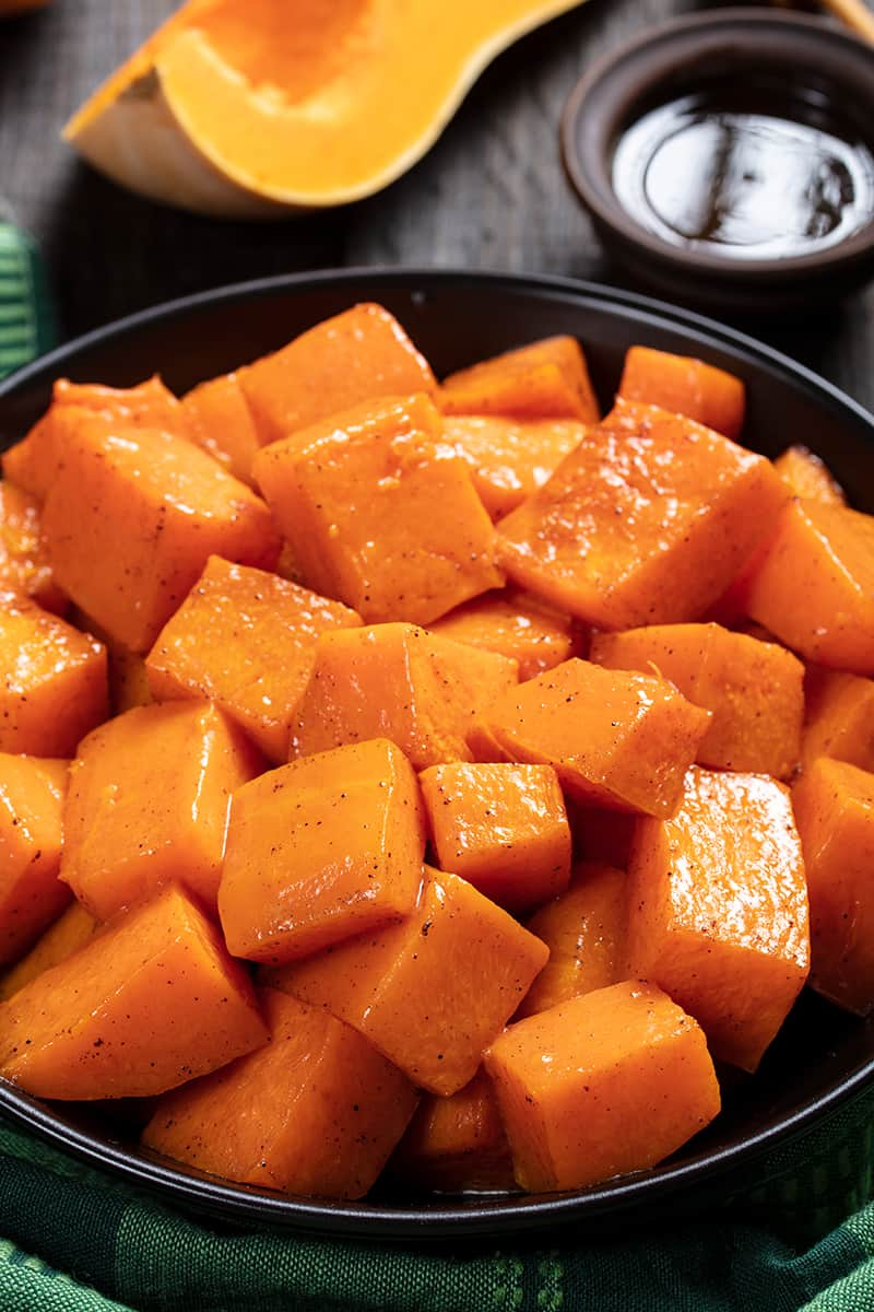 close up black serving plate with Honey & Cinnamon Roasted Butternut Squash