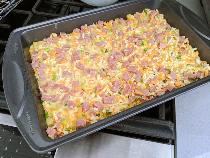 uncooked hashbrown casserole in a 9x13 pan