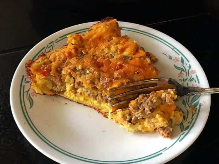 using a fork in a slice of Leftover Meatloaf Quiche in a Corelle plate