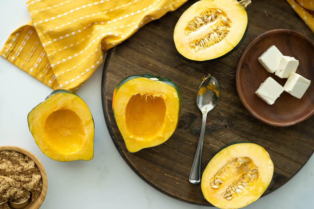 clean out acorn squash on the wooden board