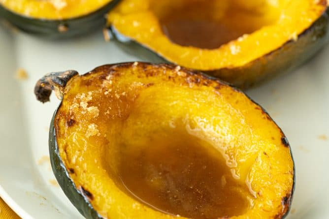 baked cuts of Acorn Squash in a white plate