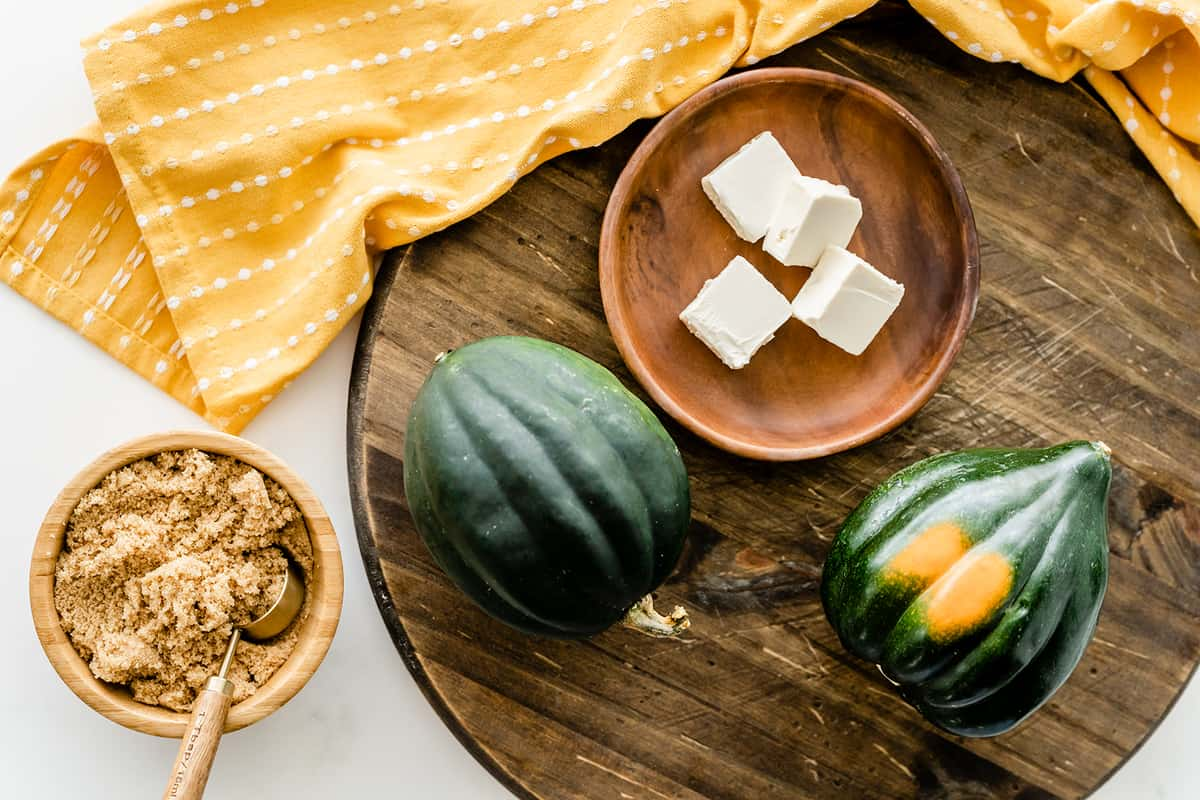 ingredients for acorn squash in wooden plate and board