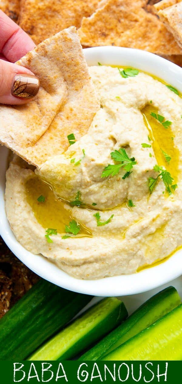 This Baba Ganoush Recipe (Baba Ganoush is a Roasted Eggplant/Aubergine Dip) is easy, healthy and a perfect way to enjoy the health benefits of eggplant, olive oil and garlic in one dip! #eggplant #aubergine #healthy #dip #LebaneseFood #pitas #vegan #vegetarian #paleo #keto #lowcarb #appetizer #chipsanddip #oliveoil
