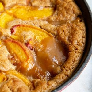 close up of Original Bisquick™ Peach Cobbler in a red large skillet