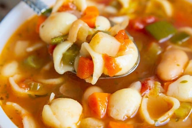 Minestrone Soup bowl topped with a sprinkle of Parmesan