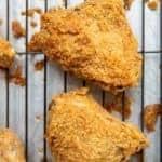 2 pieces Crispy Fried Chicken in black wire baking rack