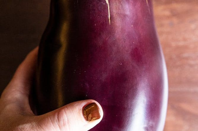 close up of a large, round and fat whole globe eggplant