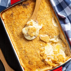 Potatoes Au Gratin topped with breadcrumbs on a casserole dish