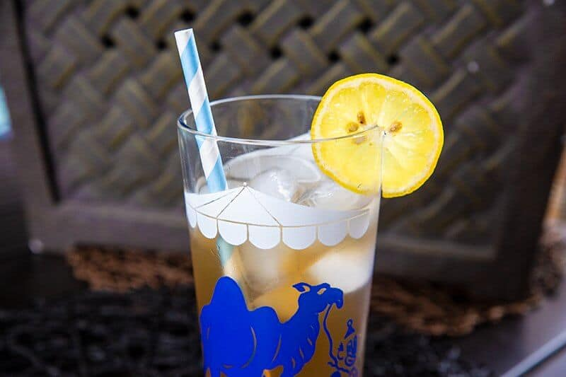 Arnold Palmer Drink in a vintage glass with ice cubes and slice of lemon for garnish