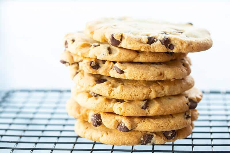 stack of Crispy Chocolate Chip Cookies in black cooling rack