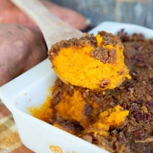 Sweet Potato Casserole in a Vintage Pyrex Butterfly Gold Casserole with a wooden sppon