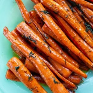 roast sliced carrots with dill in a serving tray