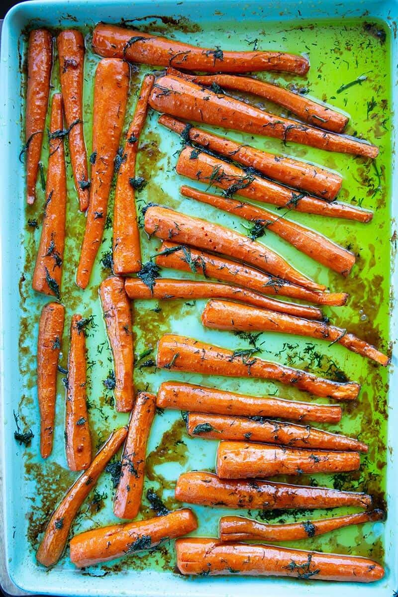 roast sliced carrots with dill in a baking pan