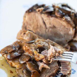 getting a slice of Boston Butt Roast with Mushroom Gravy using a fork