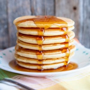 adding syrup on a stack of Bisquick® Pancakes
